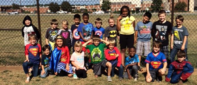 Group of kids dressed in superhero clothes